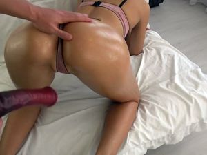Young babe with oiled ass gets her pussy...