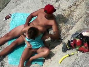 Public beach mutual rubbing...