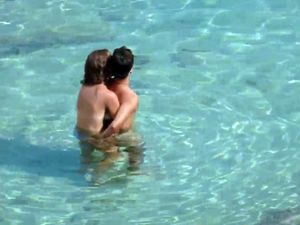 Young wife doing handjob under water in...