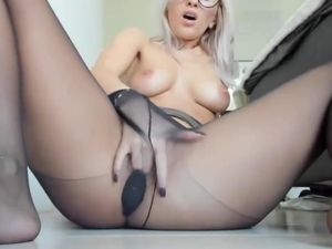 Beauty blonde squirt through black nylon