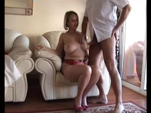 Busty mature takes off all nylons to take it