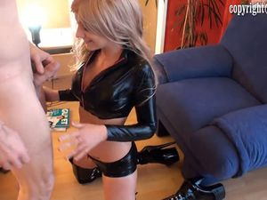 Longhaired beauty in black latex sucking