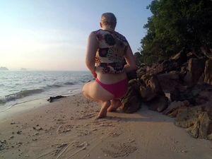 Lush teen masturbating on the beach