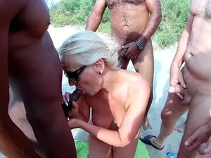 Blonde MILF covered by jizz on Cap D'agde...