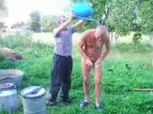 Mature dad takes shower nude outdoor