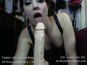 Cam slut jerks and suck big dilso during JOI