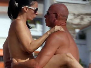 Busty wife with hubby topless on public beach