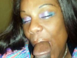 Middle-aged ebony street slut giving a...