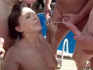 Golden shower in granny mouth during gangbang