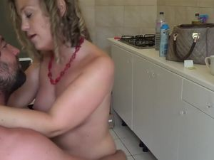 Cumming on wife's tits in the kitchen