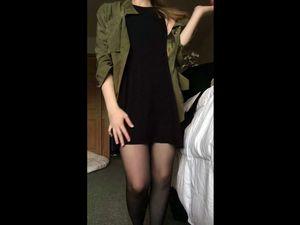 Busty brunette in stockings posing on...
