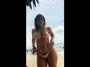Big ass beauty in sexy swimsuit at the beach