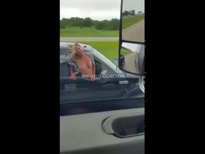 Slut flashing tits from car during moving
