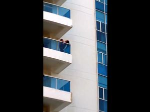 Voyeur video where couple fucks on balcony