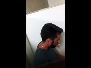 Smoking guy fuck jock in public toilet
