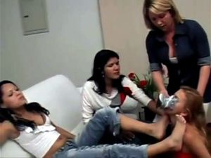Girl licks interracial girls feet while...