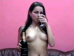 Brunette nude young girl drinks her own piss