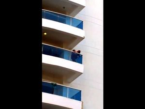 Voyeur of couple on balcony