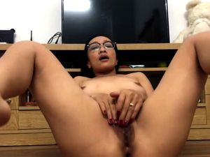 Wild asian mature plays with her hairy pussy