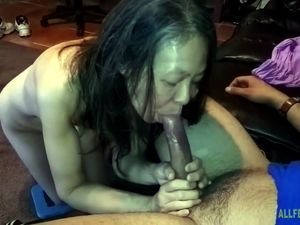 Asian slutwife measuring cock at sucking