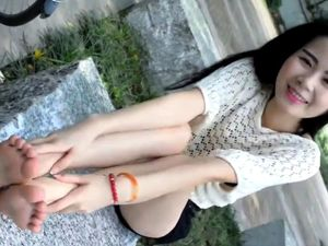 Cute chinese teen shows her feet outdor