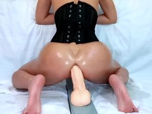 Asian whore in slave corset squirts on...