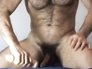 Hairy muscle dad cums while riding a dildo
