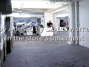 Boy by SEARS workers in the store's basement