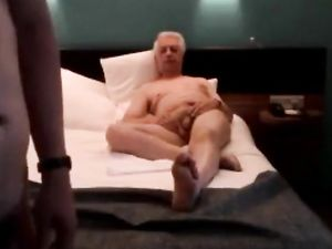 Two older guys meet in a hotel.