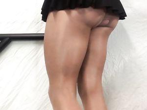 Tan thighs, cock in  black mini skirt .