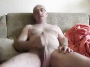 Daddy masturbating his large penis