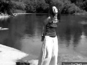 Dready hippie girl by river -v2