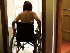 DAK amputee woman having a bath at home