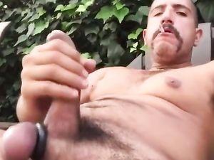 He jerks his hard uncut dick outside