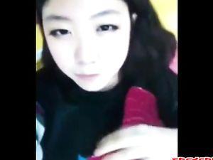 Amateur asian girl tasting herself