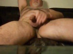 Uncut daddy bear shooting cum