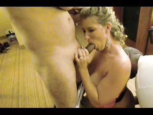 Big breasted Mrs. sucking cock...