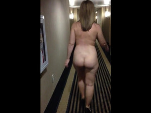 Fully nude woman walking hallway of the...