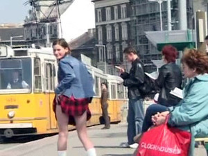 Shameless young bitch lifts her skirt at...