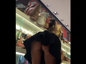 Anyone can see her cunt when she bends low
