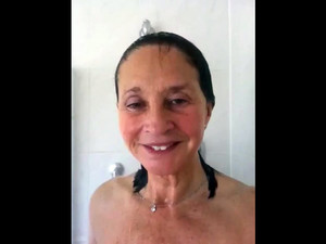Busty granny taking a shower. Looks like a...