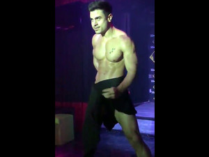 Male stripper exposes his big...