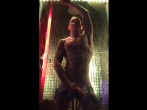 Guy dance Striptease in glass box