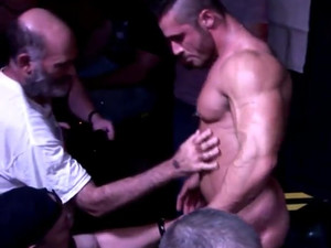 Muscled male stripper dancing for gay boys...