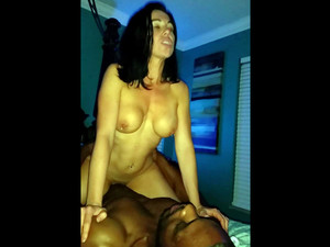 Busty hotwife riding black cock