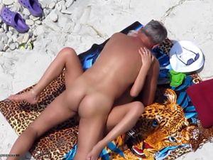 mature couple having sex on the remote beach