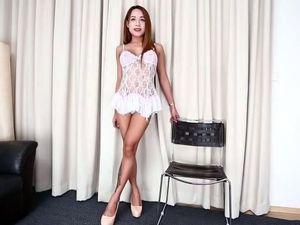A super sexy asian tranny rubs cock