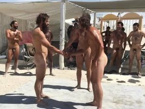 Gay nude beaches - naked male fighting