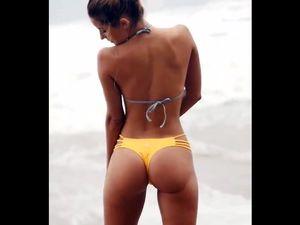 Beach girl in revealing swimsuit