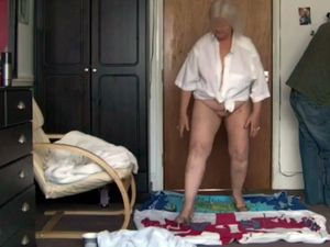 Very old granny dancing completely naked
